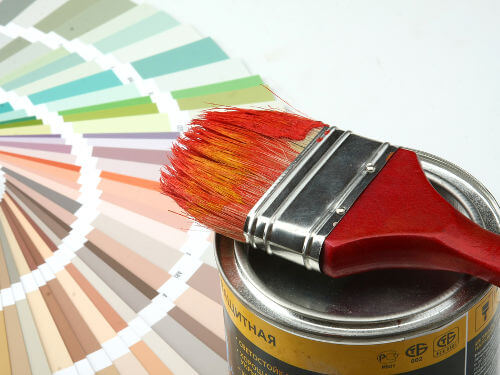 paint can, brush, and paint samples
